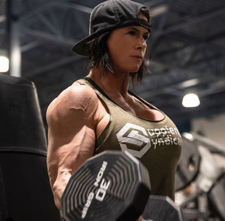 kristen nun during arm workout