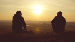 two boys  sitting  and view of sunset- true friends pictures