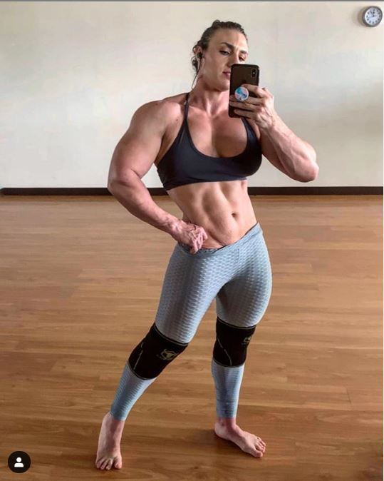 Hardcore Kaitlyn in black sports bra