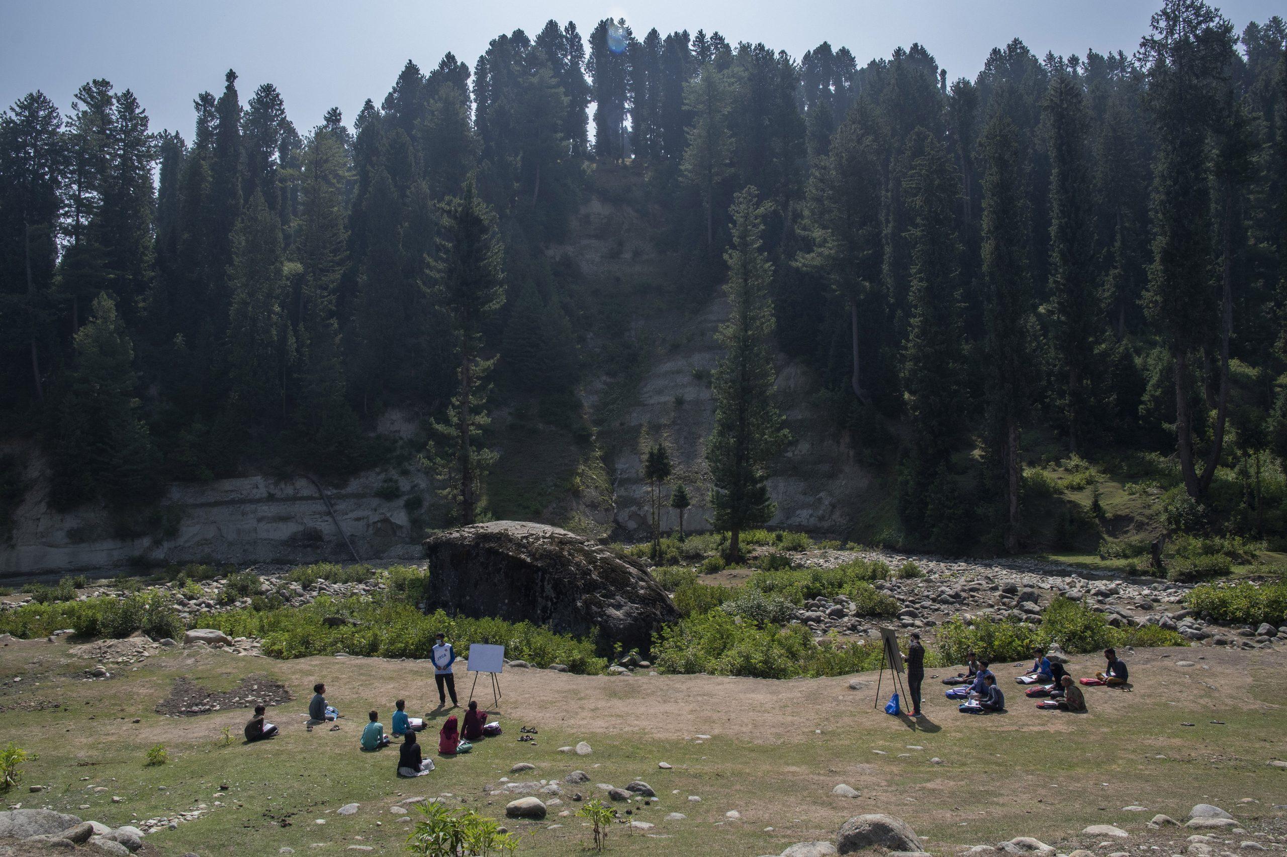 classes running in open air community school in indian kashmir valley