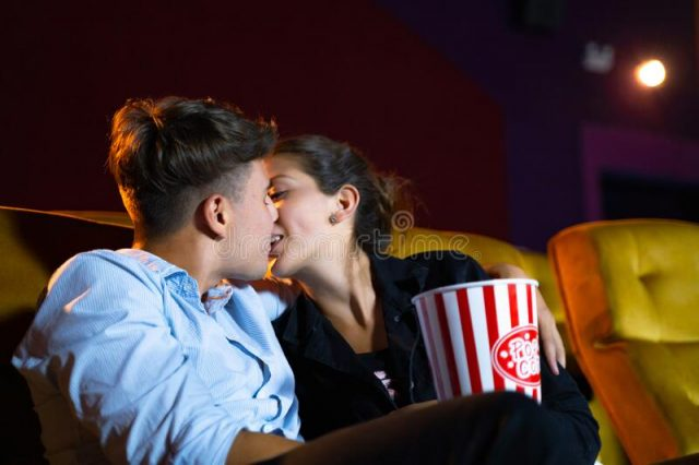 love couple-kissing-movie-theater-