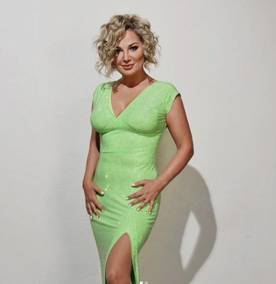 Maria Maksakova in green dress